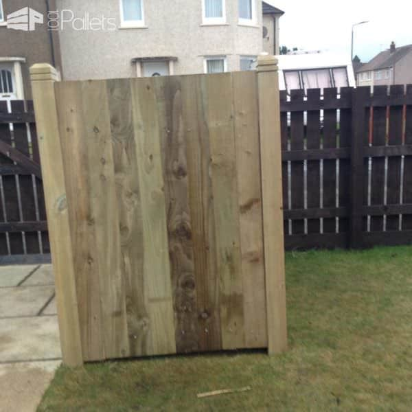 The Wheelie Bin Shed is enclosed on three sides with pallet wood.