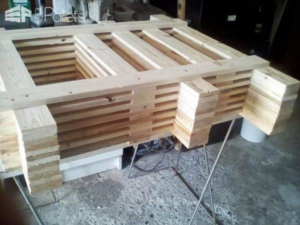Mid-assembly of the Pallet Strips TV Stand.