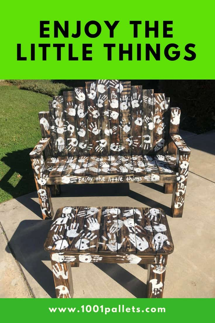 This pallet bench set is one way to enjoy the little things! With the help of two classrooms of kids, this bench will be donated to a school fundraiser! It features hand prints done in chalk paint and sealed with gloss poly. #diypalletbench