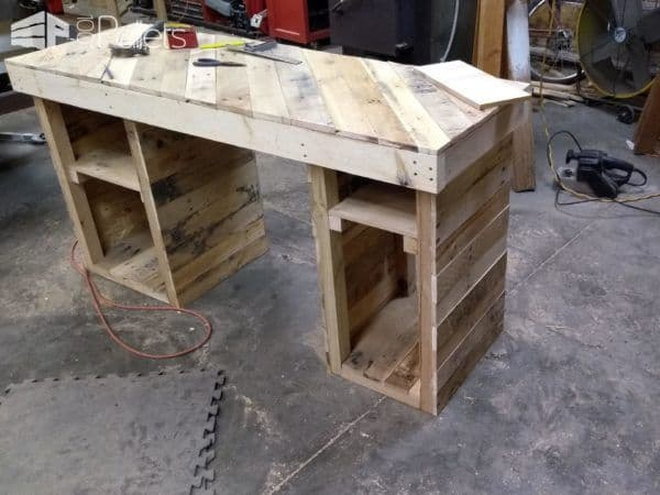 I clad the outside and top with pallet wood for my Pallet Office Desk.