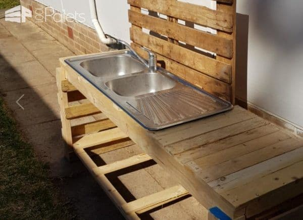 This Pallet Kid's Kitchen features a working sink.