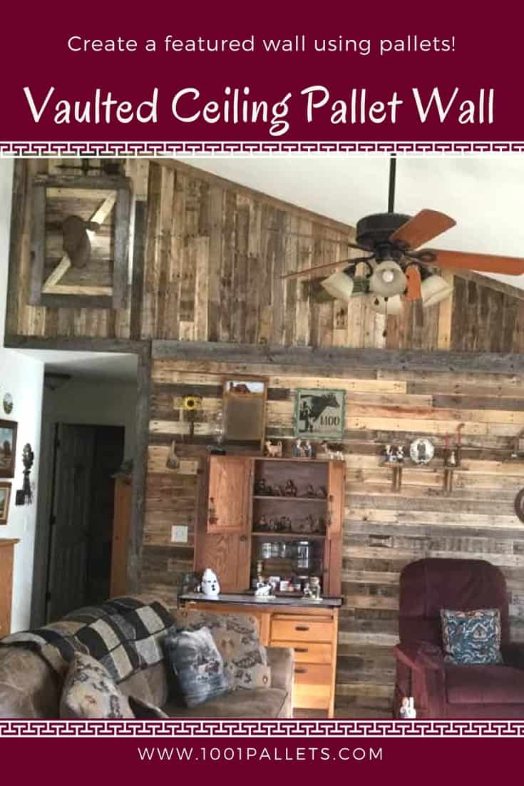Use pallets to create a stunning focal wall in your home! This project was styled after old barns, including a hayloft door, and extra shelves for displaying items! We used two directions of wood to create an old barn look. #diypalletwall