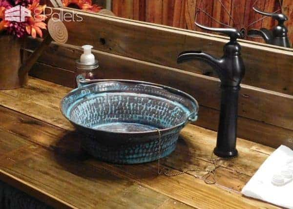 The installed faucet and basin in my Rustic Pallet Bathroom.