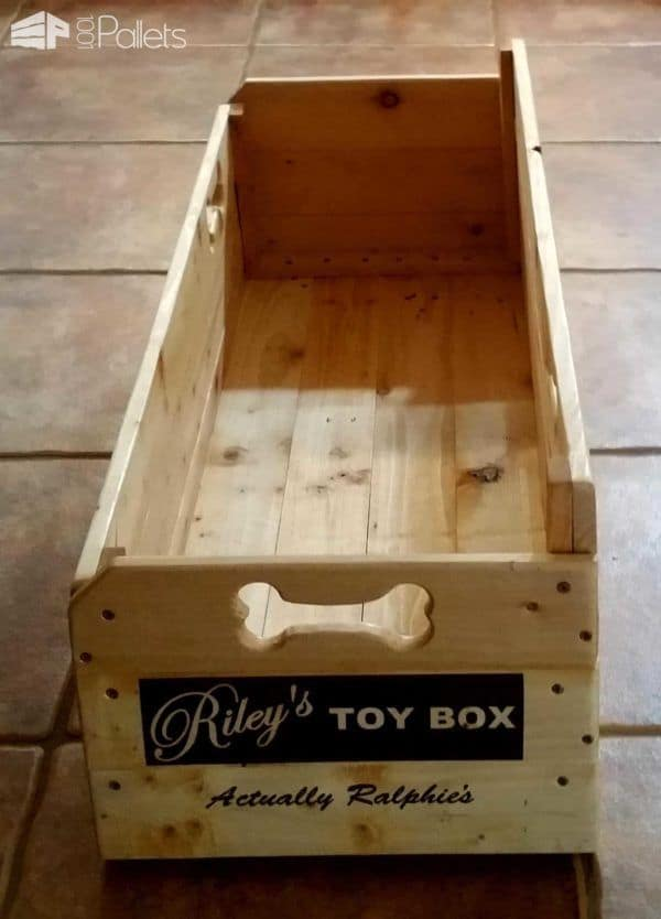 The dog bone cutouts on this Puppy Toy Box make it easy to slide or lift.