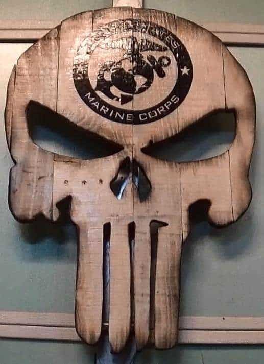 Impress your friends and make a wicked-cool gift like this Pallet Punisher Wall Art.