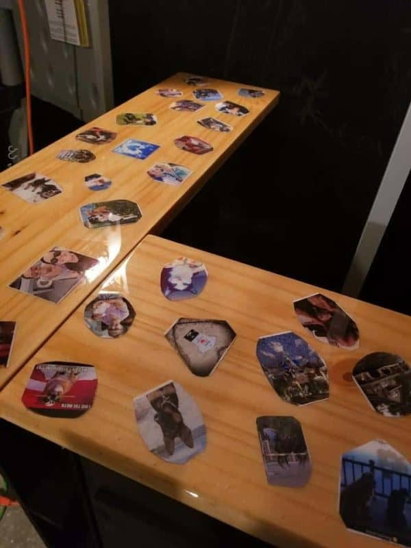 I added numerous photos to the top and attached them to the bar with Mod Podge. When the adhesive was dry, I applied three coats of epoxy to the 3 Pallet Bar to create a durable, high-gloss finish.