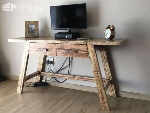 This Pallet TV stand features angled legs that are recessed flush with the table edge and angled drawers to fit into the a-frame style of this project.