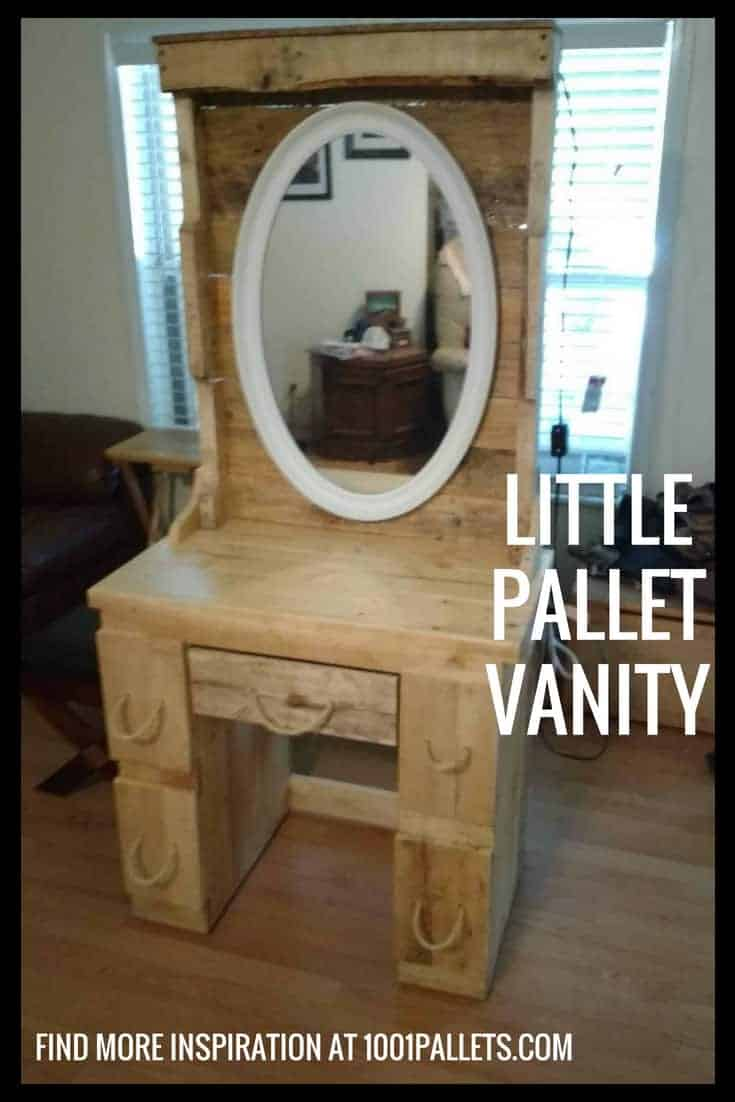 Give your granddaughter an adorable little Pallet Vanity. This features 5 drawers, a mirror, lighting above the mirror and a power strip on the right side. #diypalletvanity #vanityforgranddaughter #pallets #woodworking
