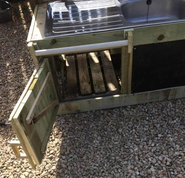 This Pallet Mud Kitchen features a large storage compartment.