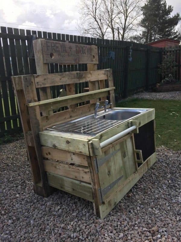 This Pallet Mud Kitchen features a large sink with a built-in drying rack for a large, fun surface for the kids.