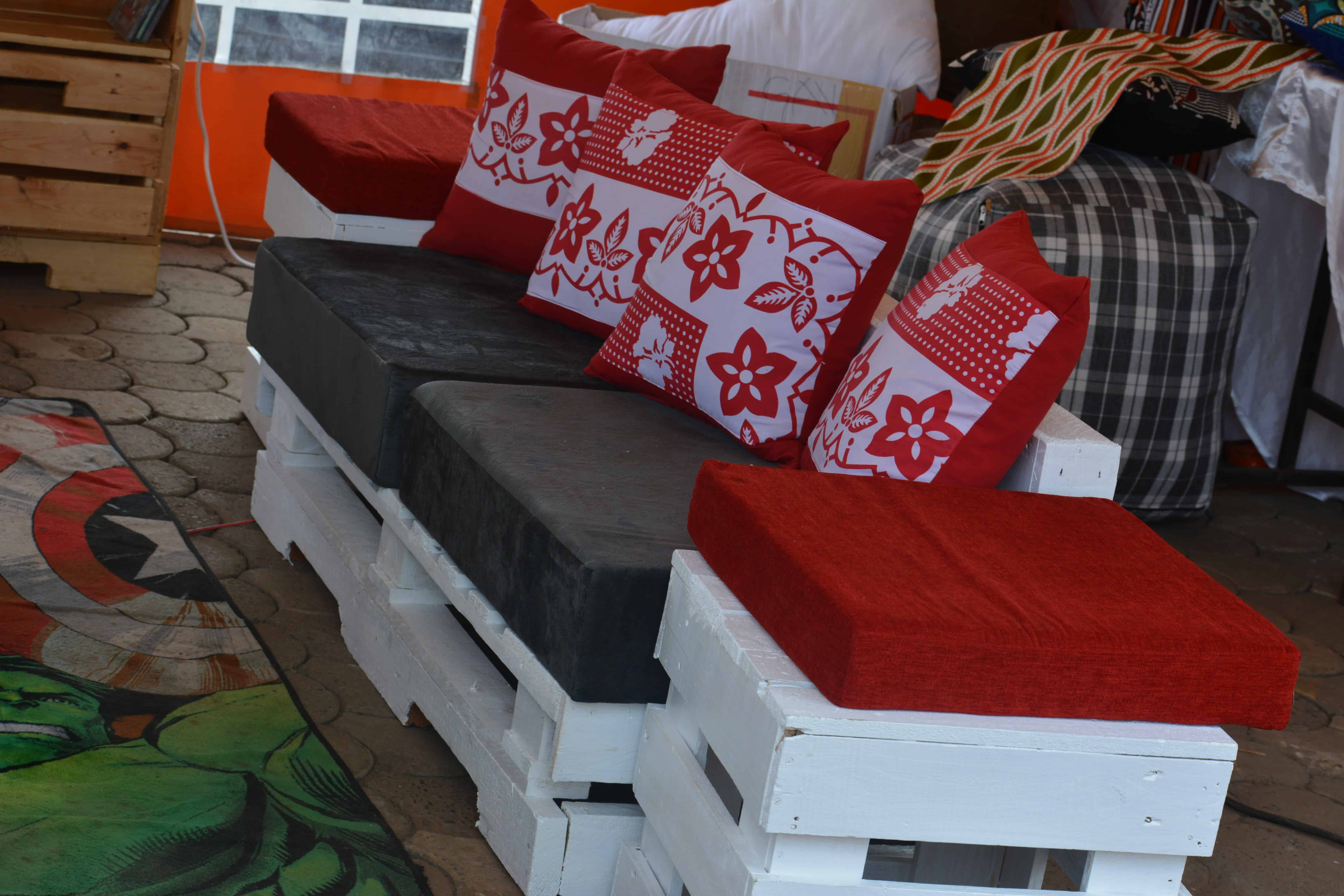 Unique Pallet Sofa With Red Cushions