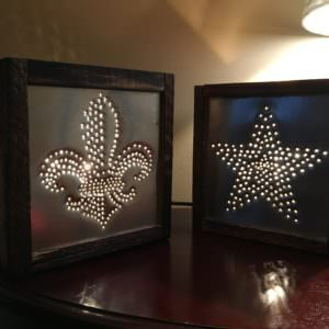 Punched Tin Pallet Lights make great gifts, and are good for indoor and outdoor living. If you make these for an outdoor space, be sure to use appropriate lighting kits, or opt for led-candles/regular candles instead.